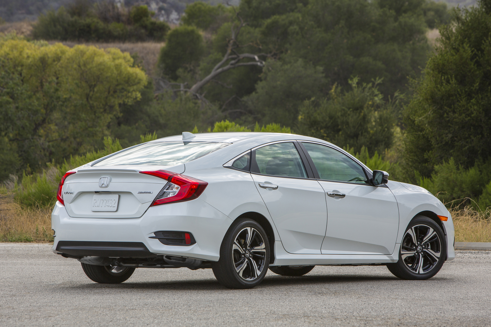 2016-Honda-Civic-Touring-rear-three-quarters-04