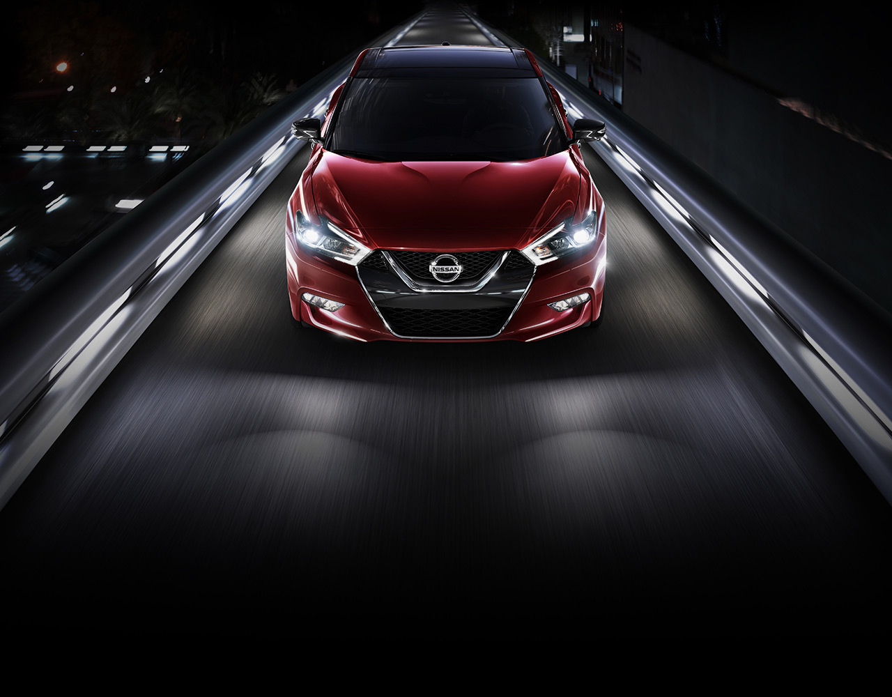 2016-nissan-maxima-coulis-red-front-aerial-view