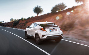 2018-toyota-c-hr-hybrid-european-spec-rear-thr-hybridee-quarter-in-motion-02