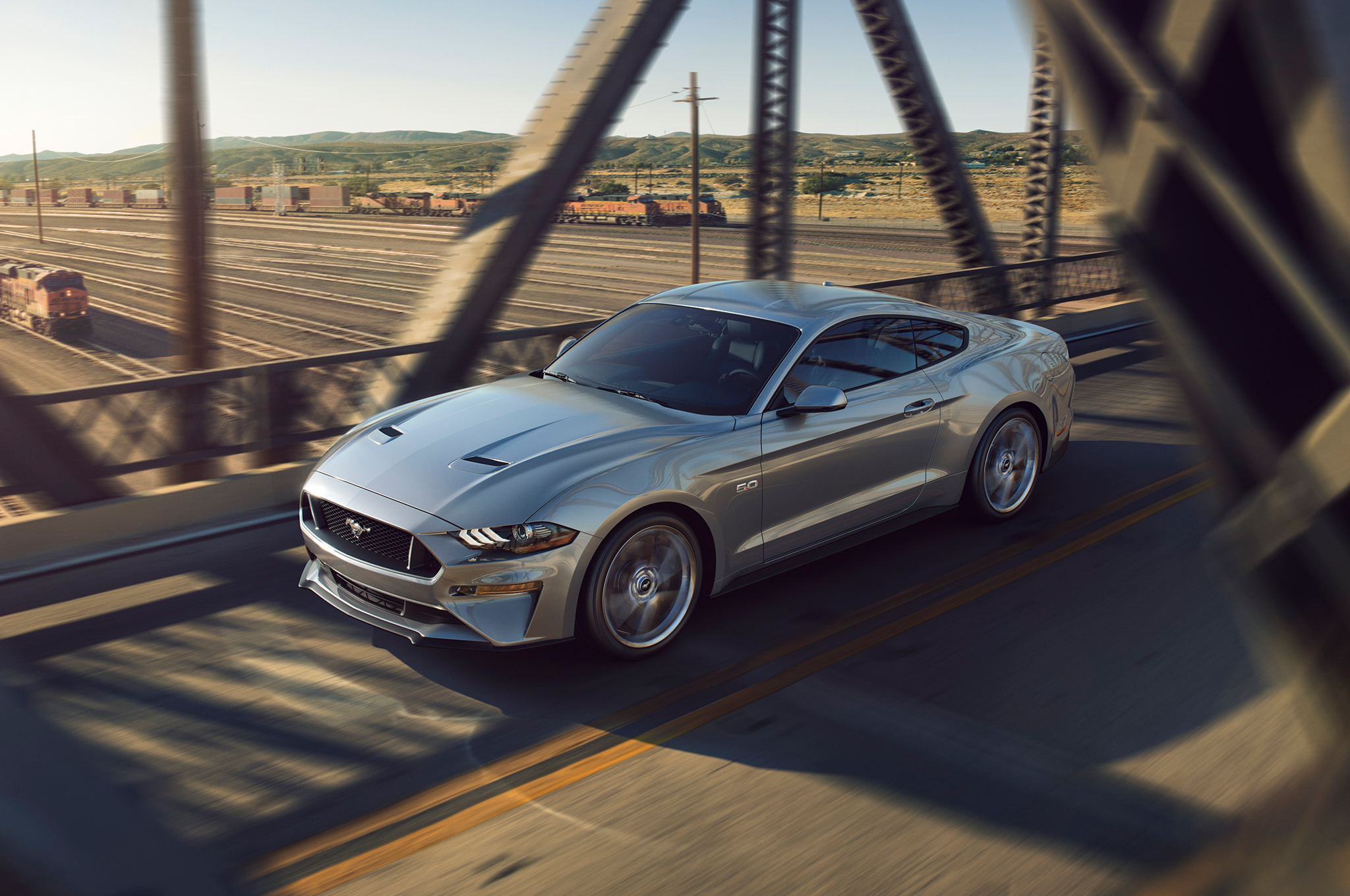 2018-Ford-Mustang-V8-GT-with-Performance-Pack-front-three-quarter-in-motion