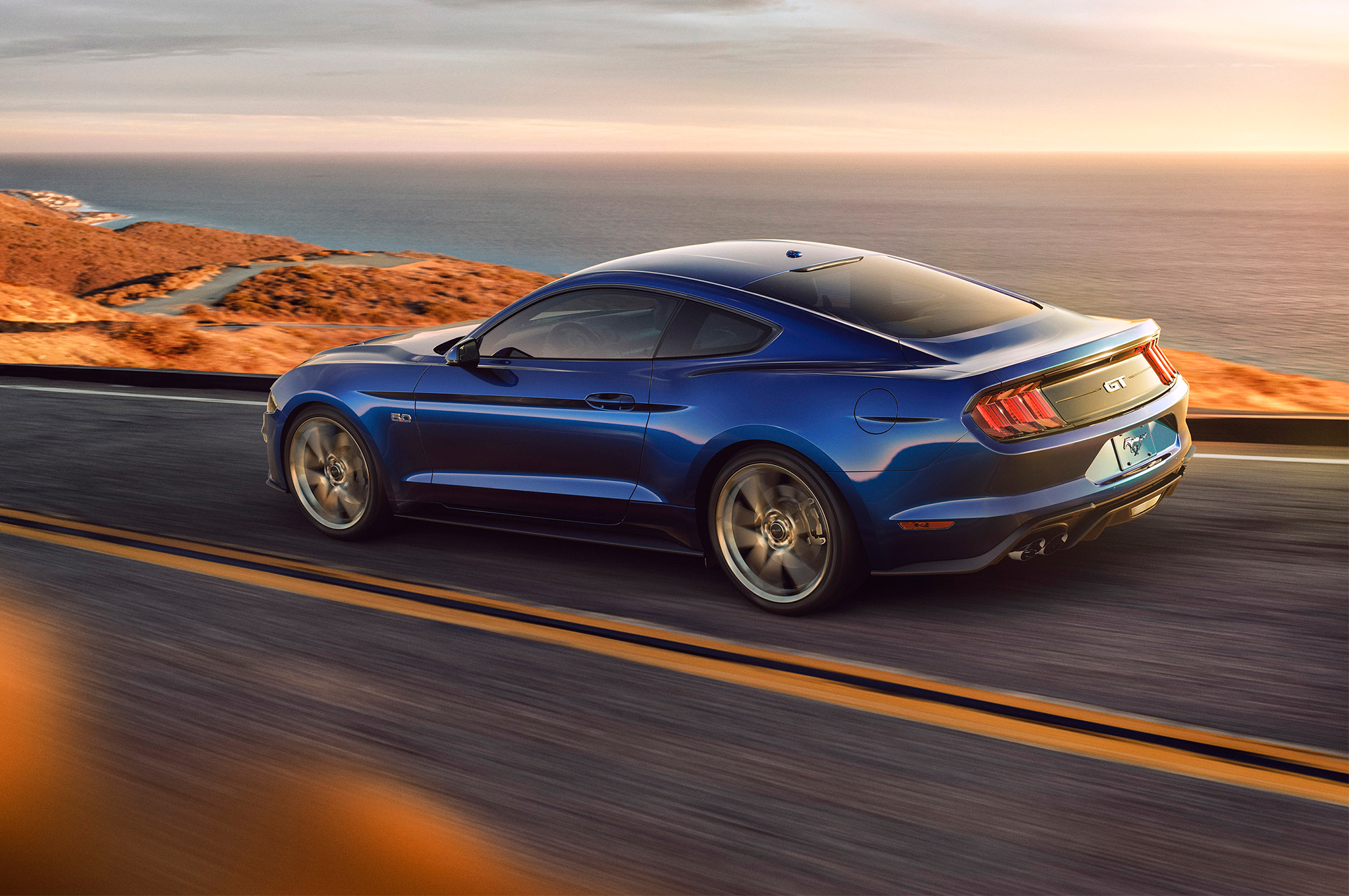 2018-Ford-Mustang-V8-GT-with-Performance-Pack-rear-three-quarter-in-motion