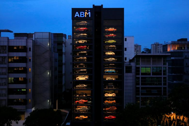 An exotic used car dealership designed to resemble a vending machine in Singapore May 15, 2017. The dealership houses up to 60 exotic cars in a 15 storey building which uses a fish-bone type lift system to deliver cars to clients within minutes.   REUTERS/Thomas White     TPX IMAGES OF THE DAY